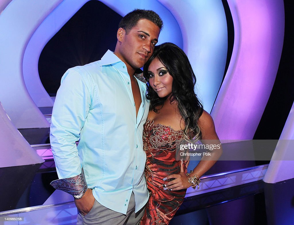 TV personality and author Nicole 'Snooki' Polizzi and Jionni LaValle arrive at the 2011 MTV Video Music Awards at Nokia Theatre LA LIVE on August 28...