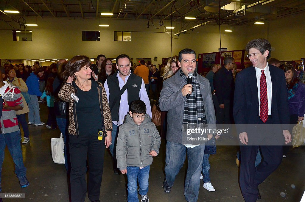 TV personality and baker Buddy Valstro and family arrive to promotes the book 'Baking Cake With The Boss' during the 2011 Chocolate World Expo at the Meadowlands Exposition Center on December 4, 2011 in Secaucus, New Jersey.