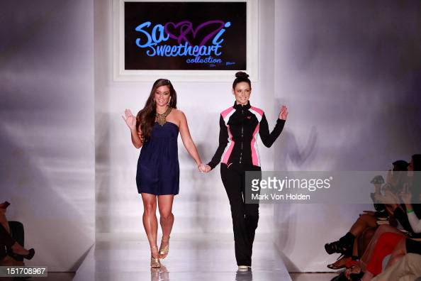 TV personality and fashion designer Sammi 'Sweetheart' Giancola walks the runway with a model during the Sammi Sweetheart Spring 2013 fashion show at...