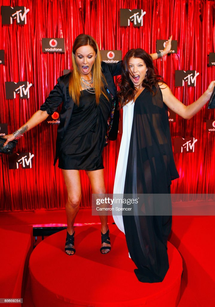 TV personality and former model Charlotte Dawson and model Jordan Lukas arrive at the Vodafone MTV Australia Awards 2009 at the Sydney Convention and...