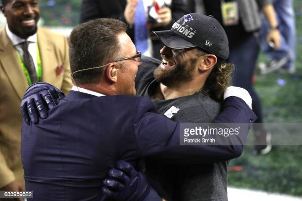 TV personality and former NFL player Howie Long celebrates with son Chris Long of the New England Patriots after defeating the Atlanta Falcons during...