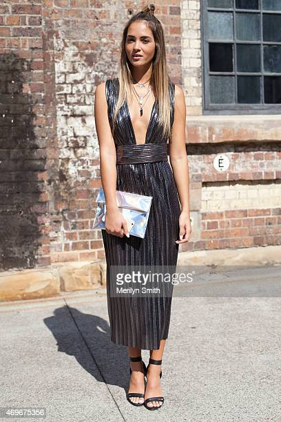 Personality and Model Aisha Jade wears a Bec and Bridge dress Lady Luna Boutique bag and Bardot shoes at MercedesBenz Fashion Week Australia 2015 at...