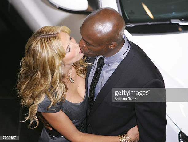 TV personality and model Heidi Klum kisses her husband and singer Seal during the presentation of the new Volkswagen model 'Tiguan' on September 27...