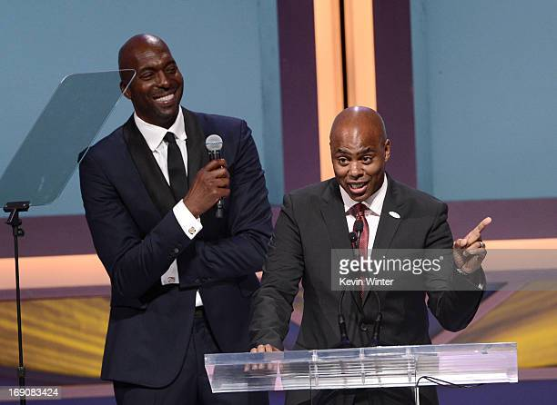 TV personality and show host Kevin Frazier and retired NBA player and radio host John Salley speak onstage at the 28th Anniversary Sports Spectacular...