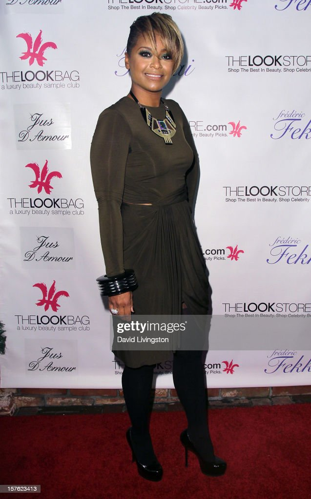 TV personality April Daniels attends the Fredric Fekkai Salon Holiday Party at Frederic Fekkai Hair Salon on December 4, 2012 in West Hollywood, California.