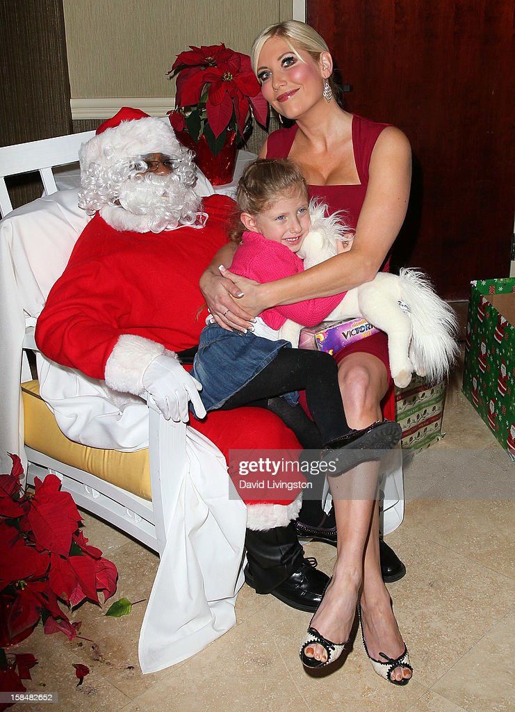 TV personality Ariane Bellamar and daughter Emma Bellamar attend the Working Dreams and Families For Children annual holiday season event at the Marriott Courtyard on December 17, 2012 in Culver City, California.