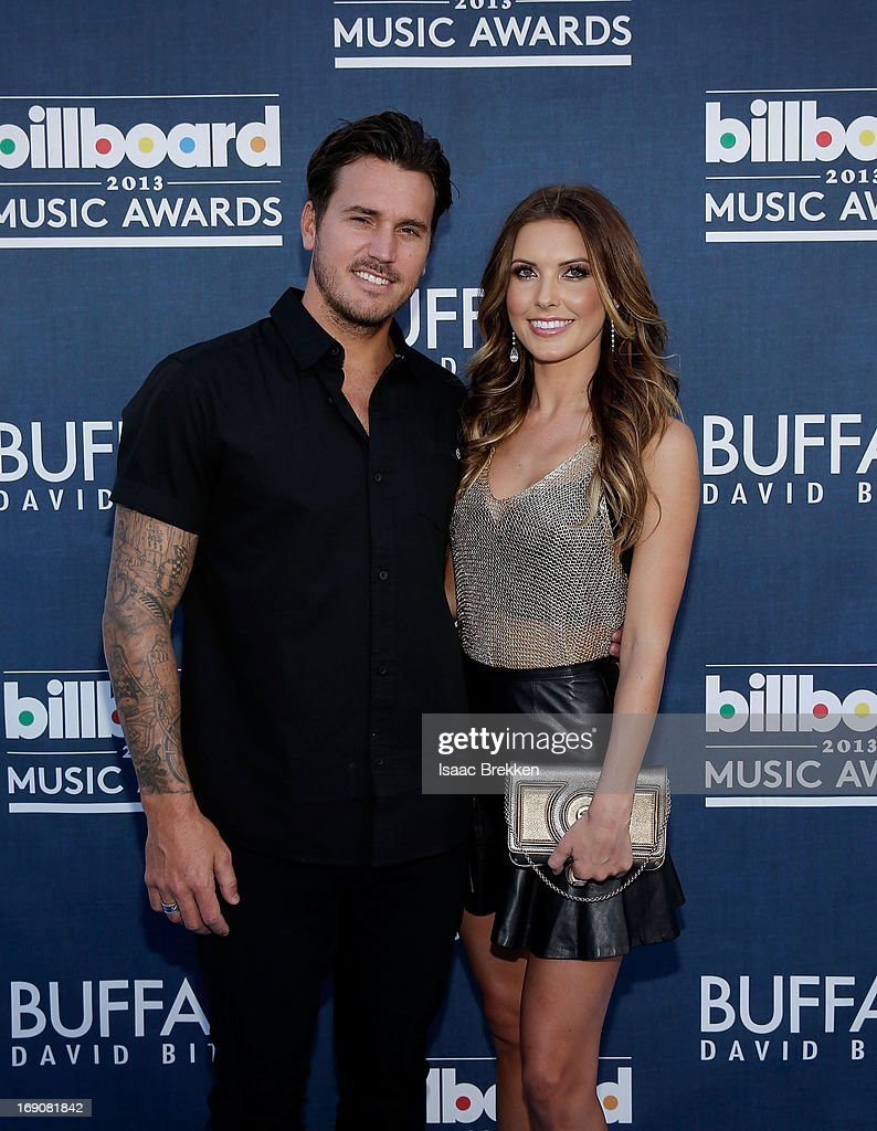TV personality <a gi-track='captionPersonalityLinkClicked' href=/galleries/search?phrase=Audrina+Patridge&family=editorial&specificpeople=2584350 ng-click='$event.stopPropagation()'>Audrina Patridge</a> (R) and <a gi-track='captionPersonalityLinkClicked' href=/galleries/search?phrase=Corey+Bohan&family=editorial&specificpeople=1053637 ng-click='$event.stopPropagation()'>Corey Bohan</a> arrive at the Buffalo David Bitton red carpet at the 2013 Billboard Music Awards at the MGM Grand Garden Arena on May 19, 2013 in Las Vegas, Nevada.