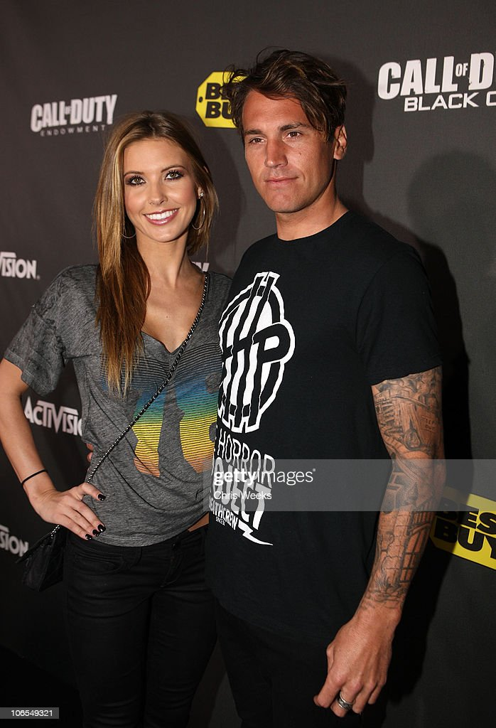 TV personality <a gi-track='captionPersonalityLinkClicked' href=/galleries/search?phrase=Audrina+Patridge&family=editorial&specificpeople=2584350 ng-click='$event.stopPropagation()'>Audrina Patridge</a> and <a gi-track='captionPersonalityLinkClicked' href=/galleries/search?phrase=Corey+Bohan&family=editorial&specificpeople=1053637 ng-click='$event.stopPropagation()'>Corey Bohan</a> arrive at the Call Of Duty: Black Ops Launch Party held at Barker Hangar on November 4, 2010 in Santa Monica, California.