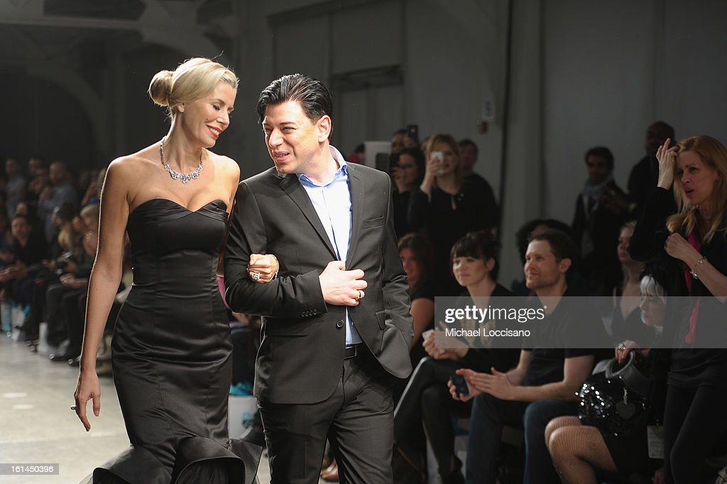 TV Personality Aviva Drescher (L) walks with designer Malan Breton during the Malan Breton fall 2013 fashion show during Mercedes-Benz Fashion Week at Pier 59 on February 10, 2013 in New York City.