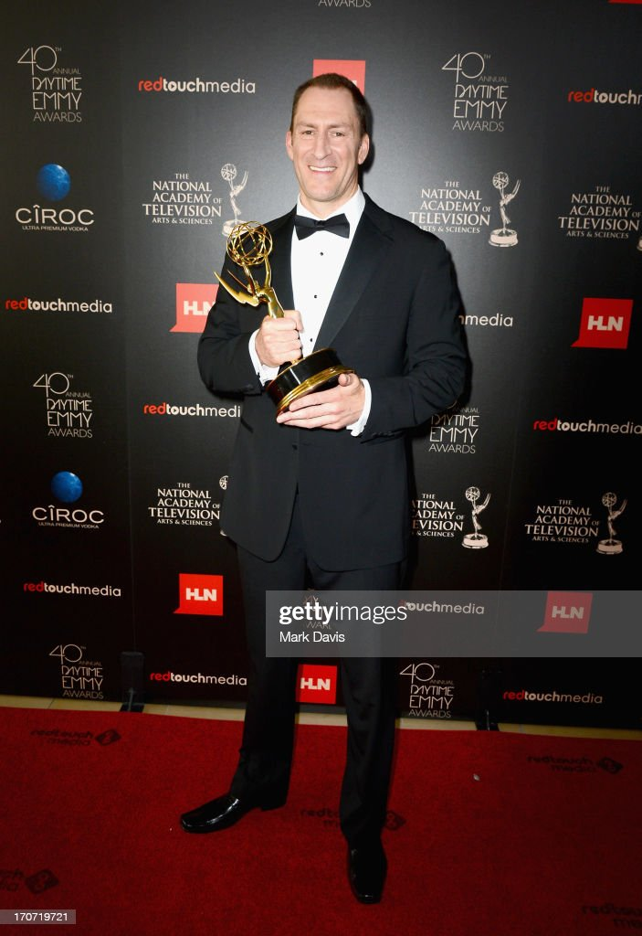 TV personality <a gi-track='captionPersonalityLinkClicked' href=/galleries/search?phrase=Ben+Bailey&family=editorial&specificpeople=3589346 ng-click='$event.stopPropagation()'>Ben Bailey</a> poses with the Outstanding Game Show Host award for 'Cash Cab' in the press room during The 40th Annual Daytime Emmy Awards at The Beverly Hilton Hotel on June 16, 2013 in Beverly Hills, California.