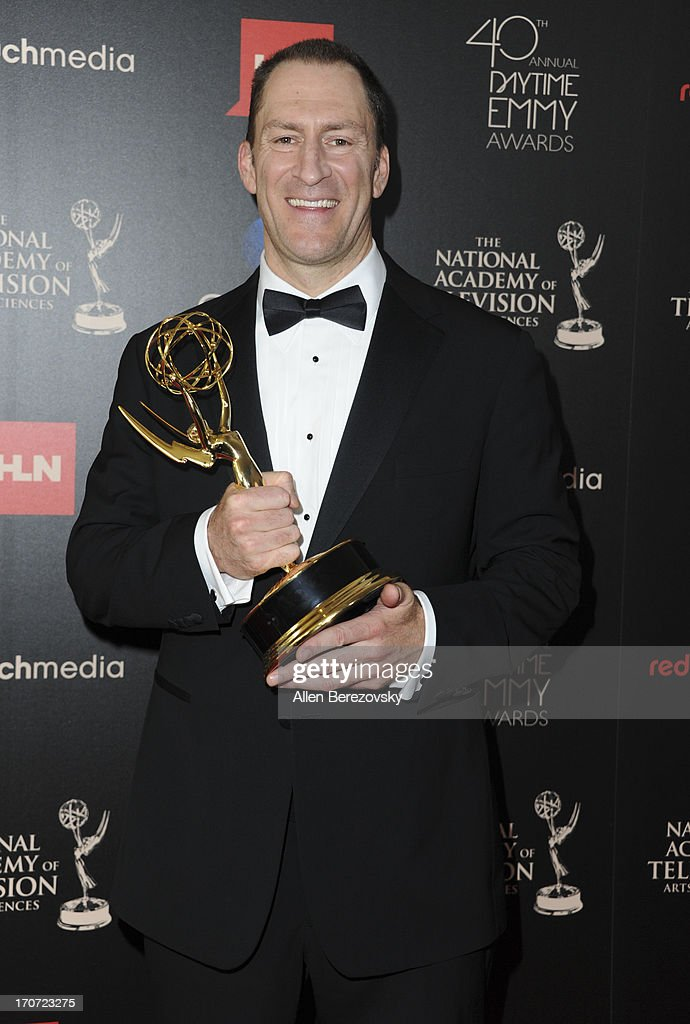 TV personality <a gi-track='captionPersonalityLinkClicked' href=/galleries/search?phrase=Ben+Bailey&family=editorial&specificpeople=3589346 ng-click='$event.stopPropagation()'>Ben Bailey</a> poses with the Outstanding Game Show Host award for 'Cash Cab' at 40th Annual Daytime Entertaimment Emmy Awards - Press Room at The Beverly Hilton Hotel on June 16, 2013 in Beverly Hills, California.