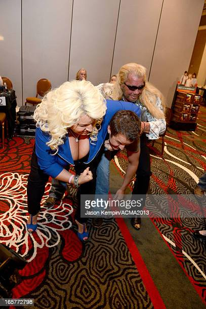 TV personality Beth Chapman recording artist Easton Corbin and TV personality Dog the Bounty Hunter attend the Dial Global Radio Remotes during The...