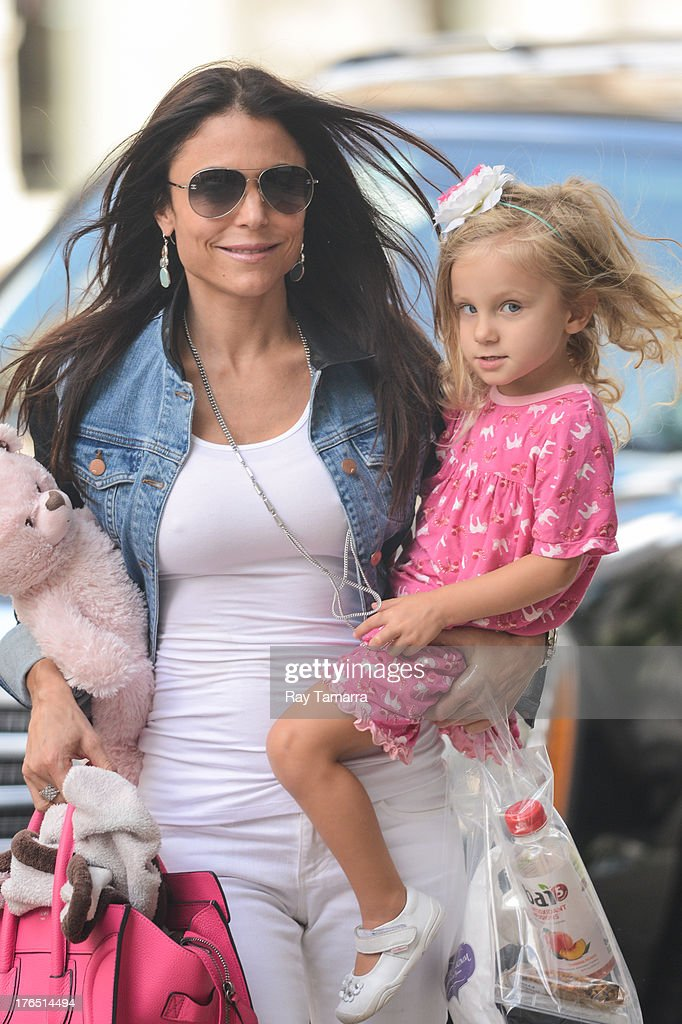 TV personality <a gi-track='captionPersonalityLinkClicked' href=/galleries/search?phrase=Bethenny+Frankel&family=editorial&specificpeople=873539 ng-click='$event.stopPropagation()'>Bethenny Frankel</a> (L) and Bryn Casey Hoppy enter their Tribeca apartment building on August 14, 2013 in New York City.