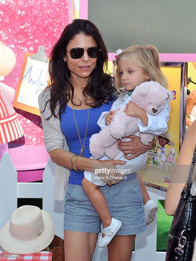 TV personality Bethenny Frankel and daughter Bryn Casey Hoppy attend the Doc Mobile Tour at the Disney Store on August 21 2013 in New York City