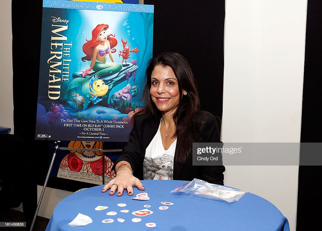 TV Personality <a gi-track='captionPersonalityLinkClicked' href=/galleries/search?phrase=Bethenny+Frankel&family=editorial&specificpeople=873539 ng-click='$event.stopPropagation()'>Bethenny Frankel</a> gets a temporary tattoo of The Little Mermaid during Disney's The Little Mermaid special screening at Walter Reade Theater on September 21, 2013 in New York City.