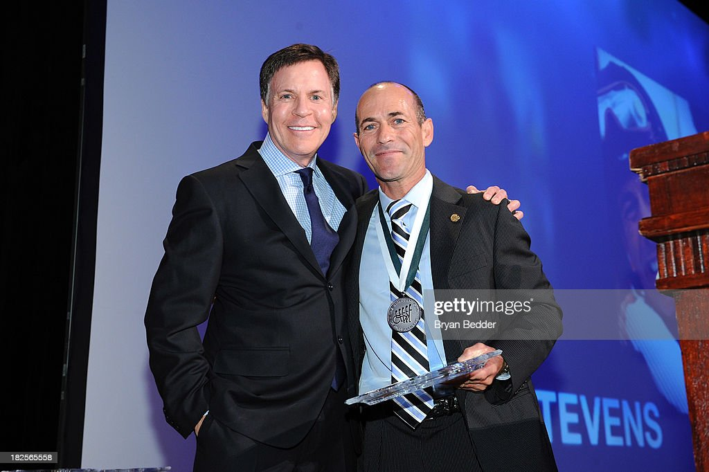 TV personality Bob Costas and Sports Legend and jockey Gary Stevens pose with award at the 28th Annual Great Sports Legends Dinner to Benefit The...