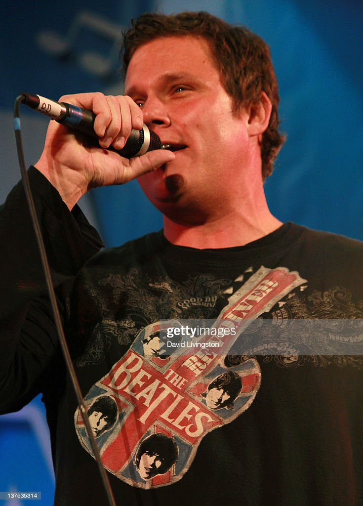 TV personality <a gi-track='captionPersonalityLinkClicked' href=/galleries/search?phrase=Bob+Guiney&family=editorial&specificpeople=212916 ng-click='$event.stopPropagation()'>Bob Guiney</a> performs on stage with Band From TV at the 110th NAMM Show - Day 3 at the Anaheim Convention Center on January 21, 2012 in Anaheim, California.