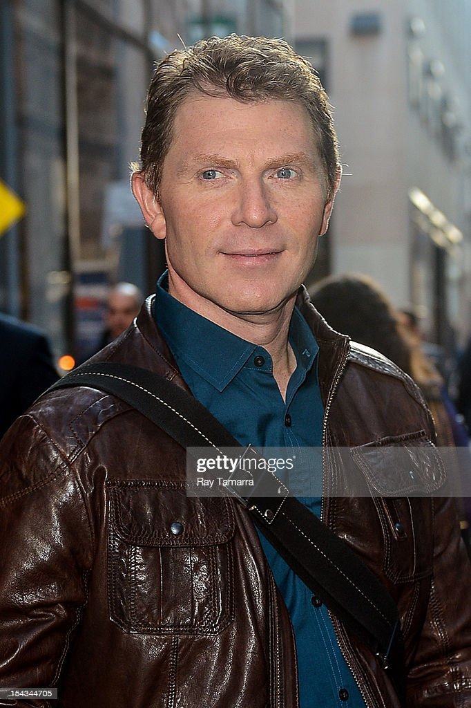 TV personality <a gi-track='captionPersonalityLinkClicked' href=/galleries/search?phrase=Bobby+Flay&family=editorial&specificpeople=220554 ng-click='$event.stopPropagation()'>Bobby Flay</a> leaves the 'Today Show' taping at the NBC Rockefeller Center Studios on October 18, 2012 in New York City.