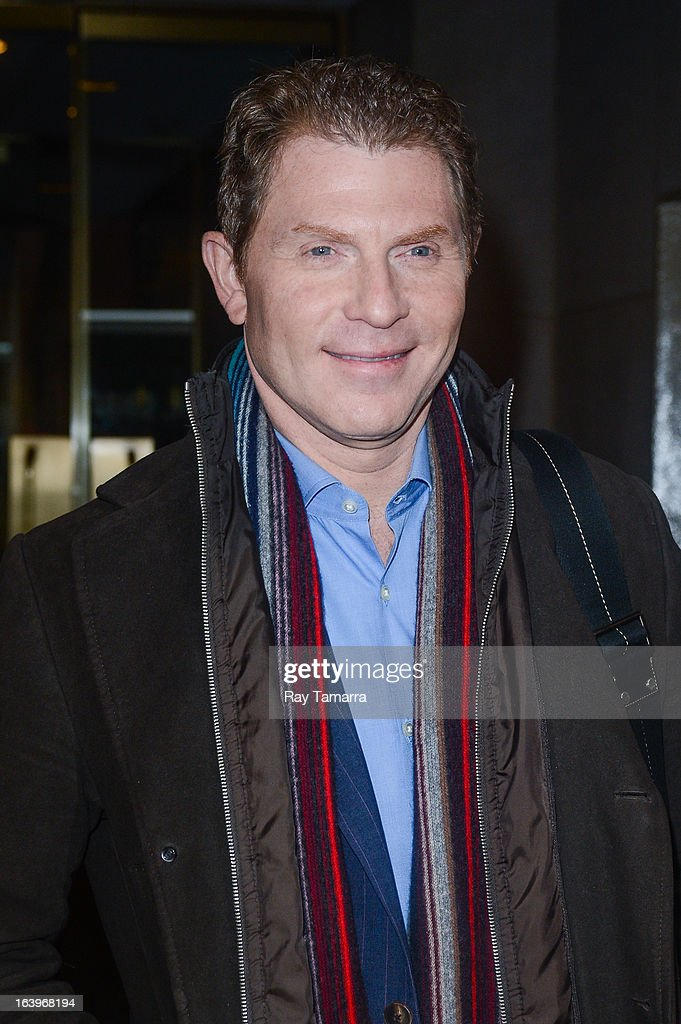 TV personality <a gi-track='captionPersonalityLinkClicked' href=/galleries/search?phrase=Bobby+Flay&family=editorial&specificpeople=220554 ng-click='$event.stopPropagation()'>Bobby Flay</a> leaves the 'Today Show' taping at the NBC Rockefeller Center Studios on March 18, 2013 in New York City.