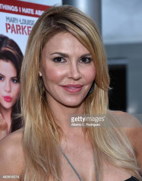 TV personality Brandi Glanville arrives to the premiere of Mad Chance's 'Behaving Badly' at the ArcLight Hollywood on July 29 2014 in Hollywood...