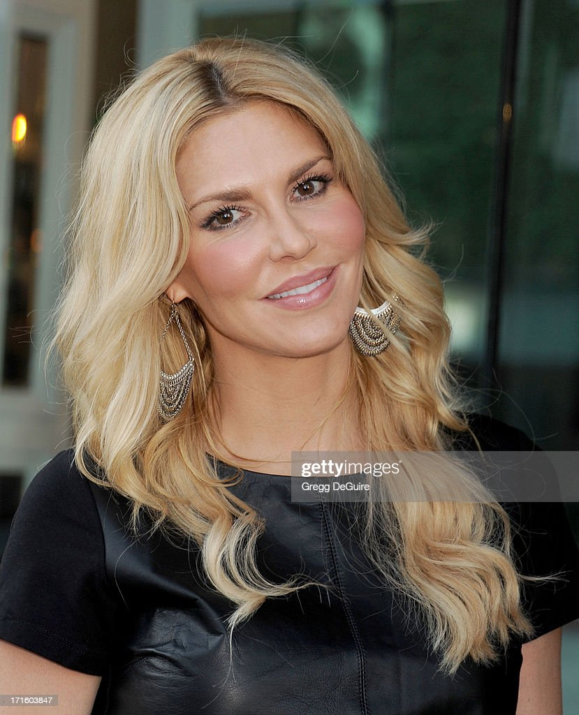 TV personality Brandi Glanville of The Real Housewives of Beverly Hills arrives at a fashion fundraiser hosted by Kyle Richards benefiting Children's Hospital Los Angeles at Kyle by Alene Too on June 26, 2013 in Beverly Hills, California.