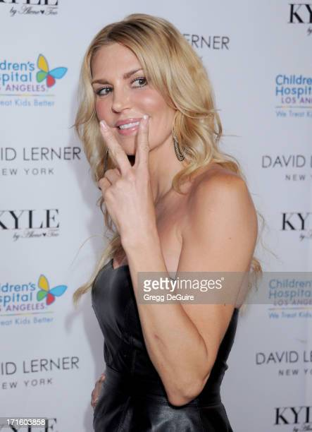 TV personality Brandi Glanville of The Real Housewives of Beverly Hills arrives at a fashion fundraiser hosted by Kyle Richards benefiting Children's...