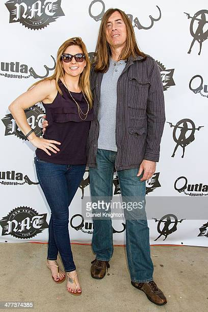 TV personality Brandi Passante and actor Jim Mitchell arrive at the 'Storage Wars' Season 4 Premiere Party at Now Then on March 8 2014 in Orange...