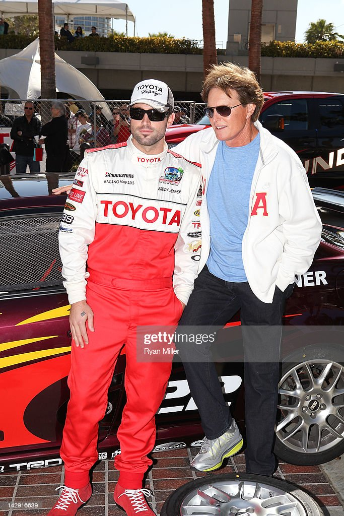 TV personality Brody Jenner (L) and father Bruce Jenner (R) pose during the 36th Annual Toyota Pro/Celebrity Race held at the Toyota Grand Prix of Long Beach on April 14, 2012 in Long Beach, California.