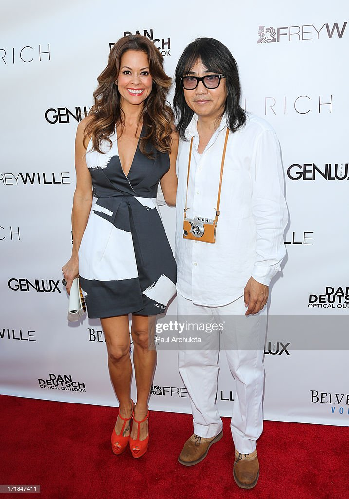 TV Personality Brooke Burke Charvet (L) and Creative Director Stephen Kamifuji (R) attend the Genlux Magazine summer issue release party at the Luxe Rodeo Drive Hotel on June 28, 2013 in Beverly Hills, California.