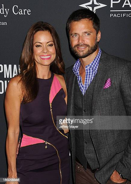 TV personality Brooke BurkeCharvet and actor David Charvet attend The Pink Party 2013 at Barker Hangar on October 19 2013 in Santa Monica California