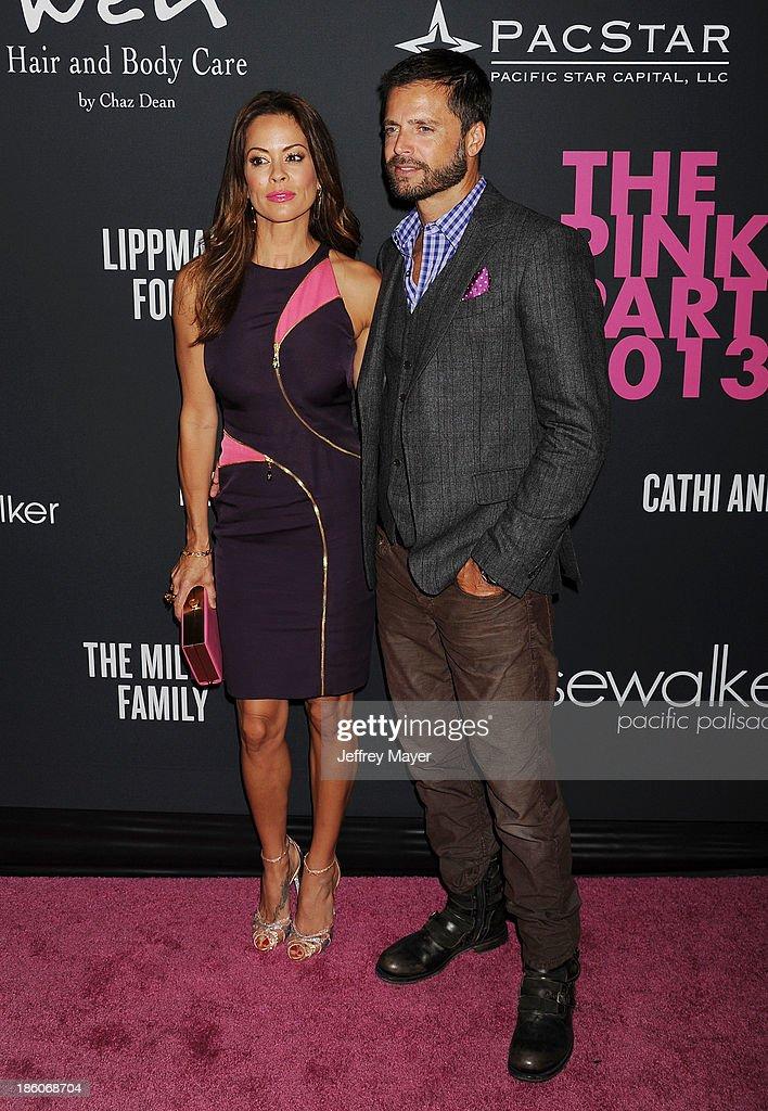 TV personality Brooke BurkeCharvet and actor David Charvet attend The Pink Party 2013 at Barker Hangar on October 19 2013 in Santa Monica California