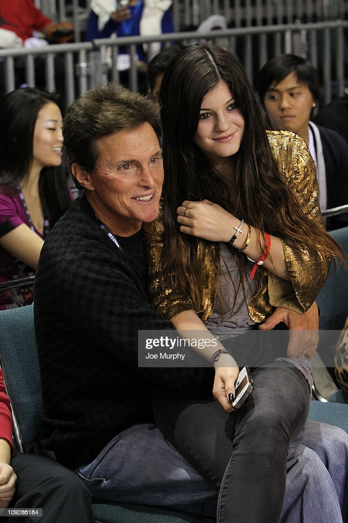 Personality Bruce Jenner and daughter Kylie Kardashian react to a play during the BBVA 2011 NBA AllStar Celebrity Game on center court at Jam Session...