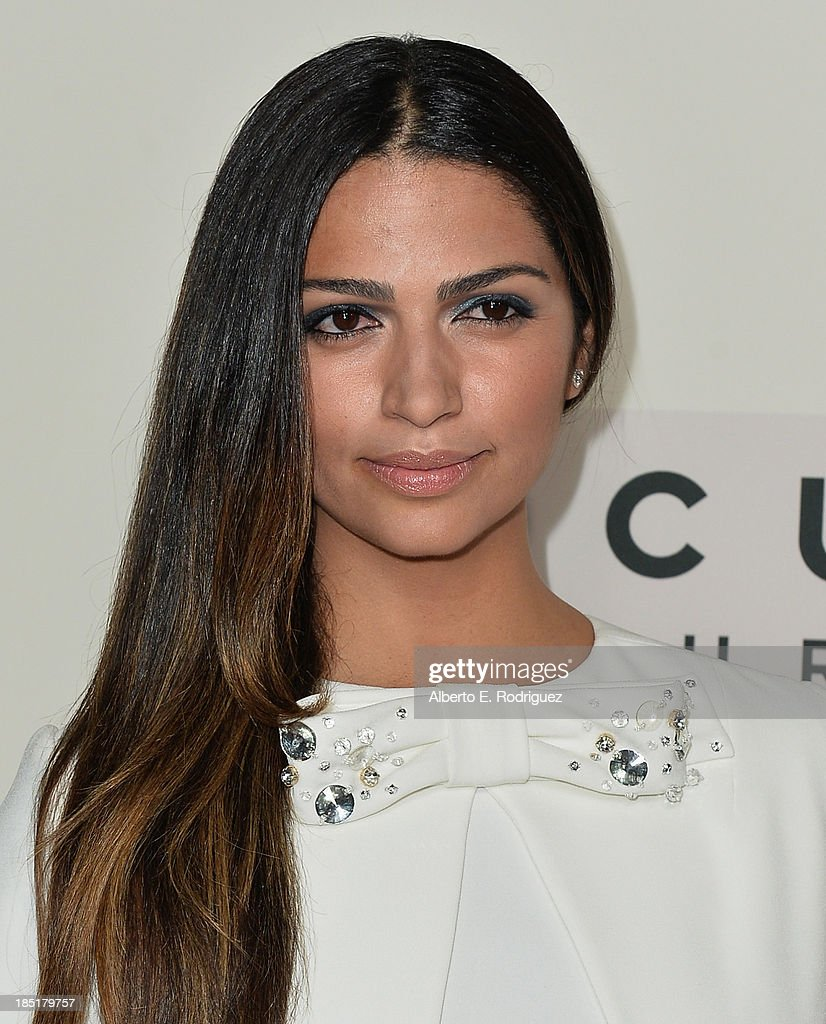 TV personality <a gi-track='captionPersonalityLinkClicked' href=/galleries/search?phrase=Camila+Alves&family=editorial&specificpeople=4501431 ng-click='$event.stopPropagation()'>Camila Alves</a> attends Focus Features' 'Dallas Buyers Club' premiere at the Academy of Motion Picture Arts and Sciences on October 17, 2013 in Beverly Hills, California.