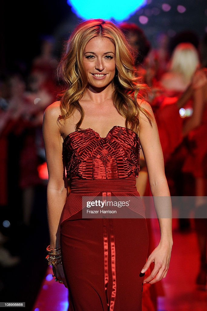 TV personality <a gi-track='captionPersonalityLinkClicked' href=/galleries/search?phrase=Cat+Deeley&family=editorial&specificpeople=202554 ng-click='$event.stopPropagation()'>Cat Deeley</a> walks the runway at the Heart Truth Fall 2011 fashion show during Mercedes-Benz Fashion Week at The Theatre at Lincoln Center on February 9, 2011 in New York City.