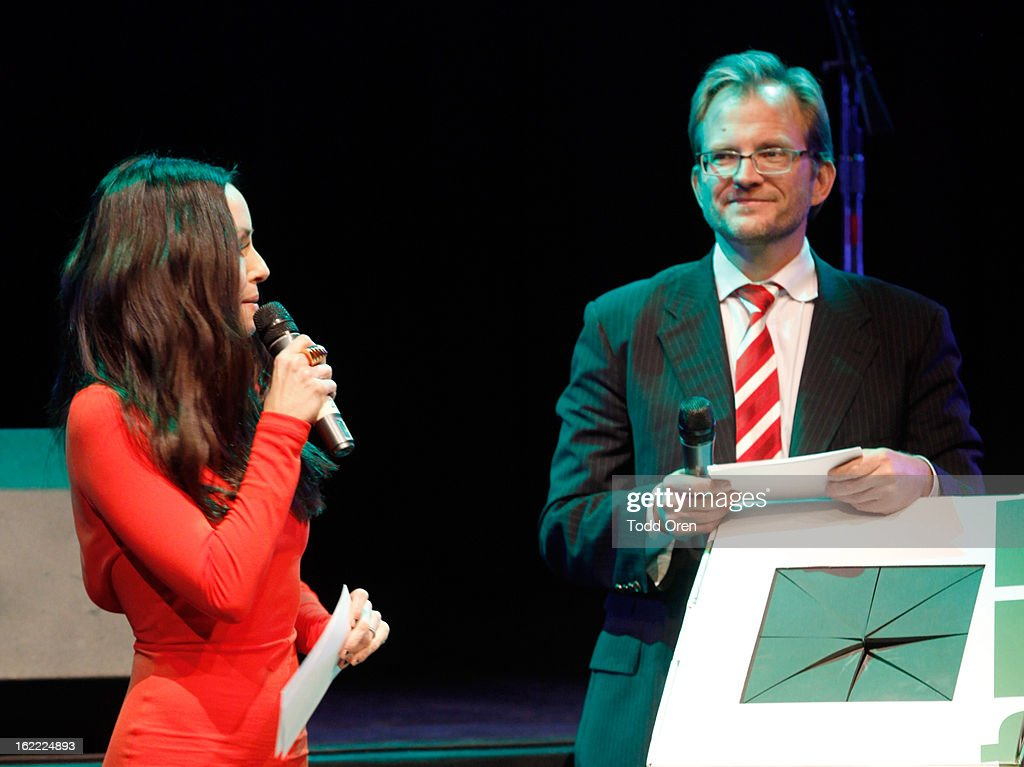 TV personality Catt Sadler speaks on stage while CEO of Global Green USA Matt Petersen stands nearby during Global Green USA's 10th Annual Pre-Oscar Party at Avalon on February 20, 2013 in Hollywood, California.