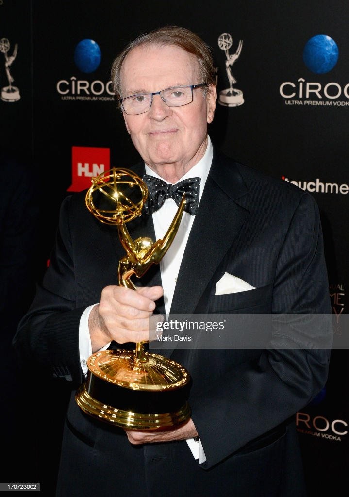 TV personality Charles Osgood poses with the Outstanding Morning Program award for 'CBS Sunday Morning' in the press room during The 40th Annual Daytime Emmy Awards at The Beverly Hilton Hotel on June 16, 2013 in Beverly Hills, California.