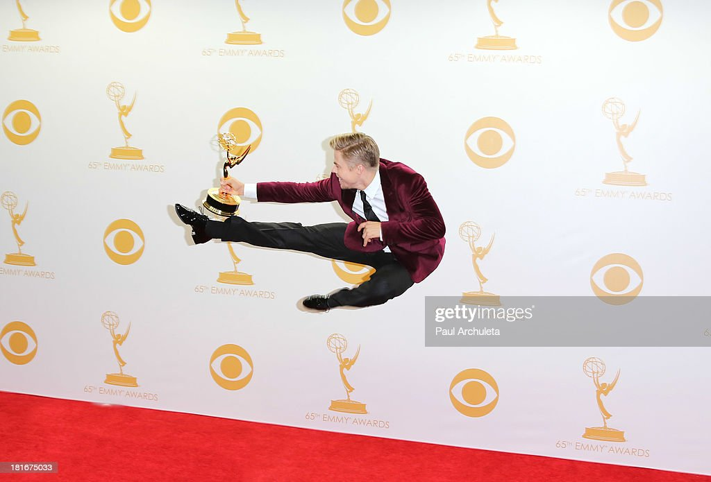 TV Personality / Choreographer <a gi-track='captionPersonalityLinkClicked' href=/galleries/search?phrase=Derek+Hough&family=editorial&specificpeople=4532214 ng-click='$event.stopPropagation()'>Derek Hough</a> poses in the press room at the 65th annual Primetime Emmy Awards at Nokia Theatre L.A. Live on September 22, 2013 in Los Angeles, California.
