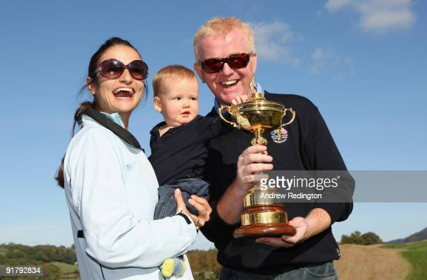 TV personality Chris Evans his wife Natasha and son Noah pose with the Ryder Cup after the 'Year to Go' exhibition match on the Twenty Ten Course at...