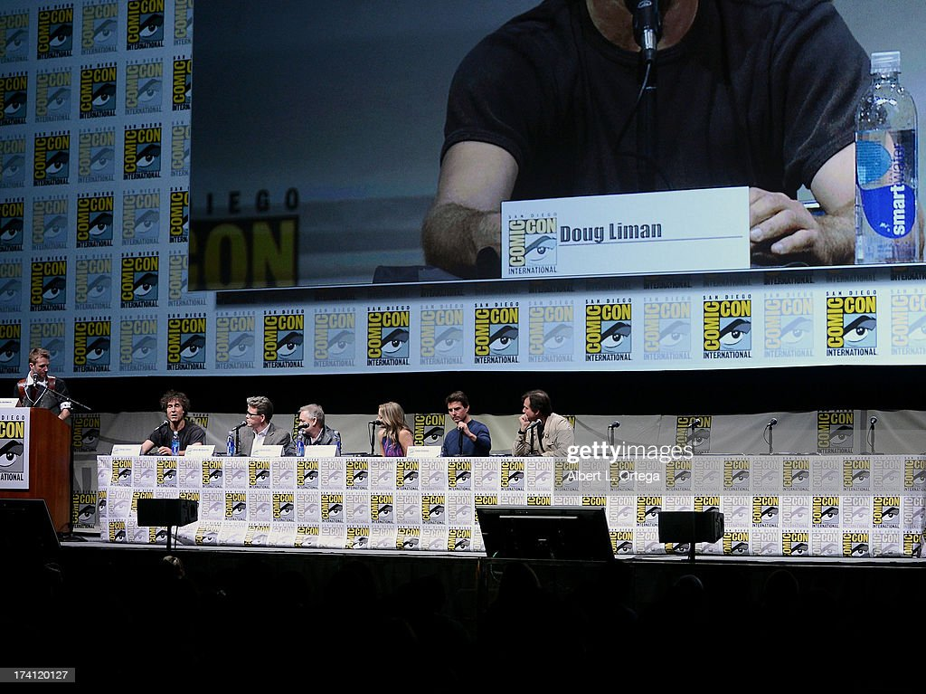 TV personality Chris Hardwick, director Doug Liman, screenwriter Christopher McQuarrie, producer Erwin Stoff, actress Emily Blunt, actor Tom Cruise and actor Bill Paxton speak onstage at the Warner Bros. and Legendary Pictures preview of 'Edge of Tomorrow' during Comic-Con International 2013 at San Diego Convention Center on July 20, 2013 in San Diego, California.