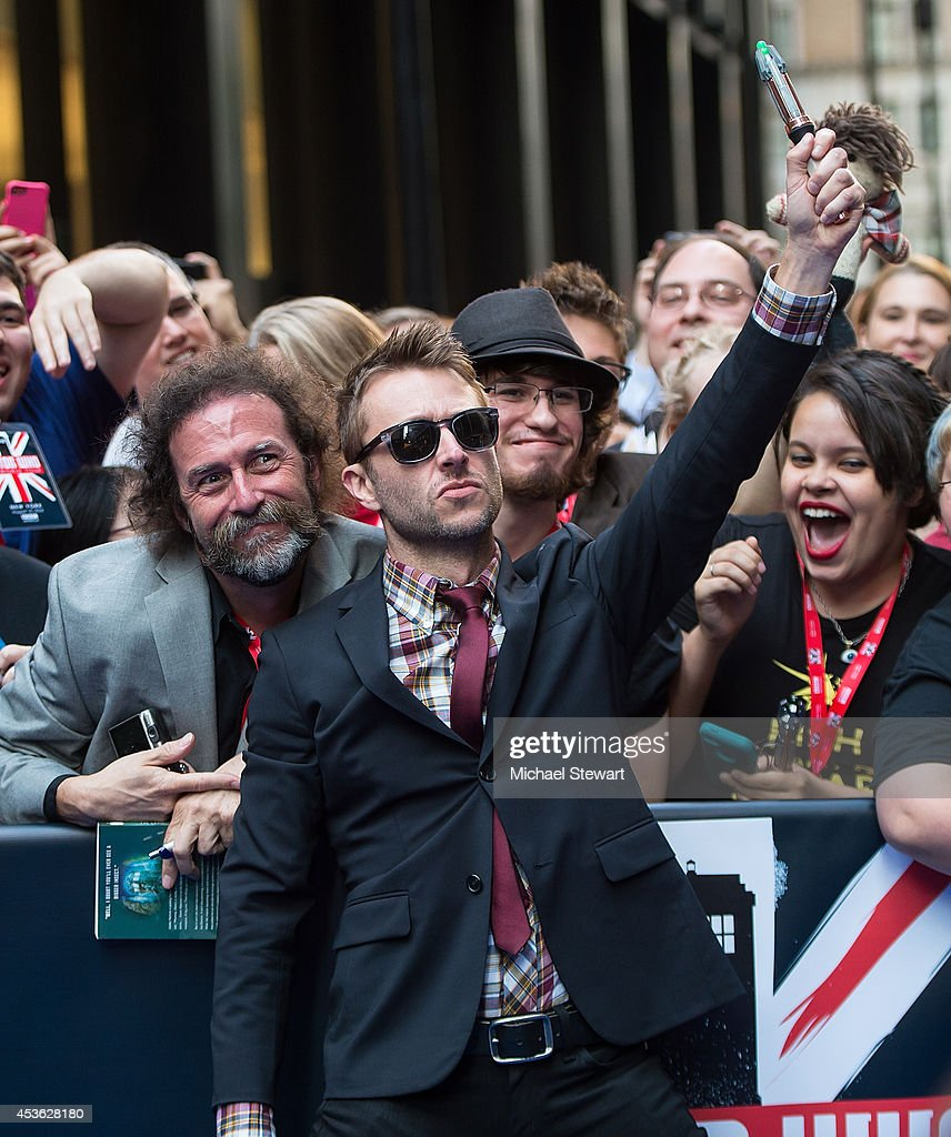 TV personality <a gi-track='captionPersonalityLinkClicked' href=/galleries/search?phrase=Chris+Hardwick&family=editorial&specificpeople=960855 ng-click='$event.stopPropagation()'>Chris Hardwick</a> (C) poses with fan at BBC America's 'Doctor Who' Premiere Fan Screening at Ziegfeld Theater on August 14, 2014 in New York City.