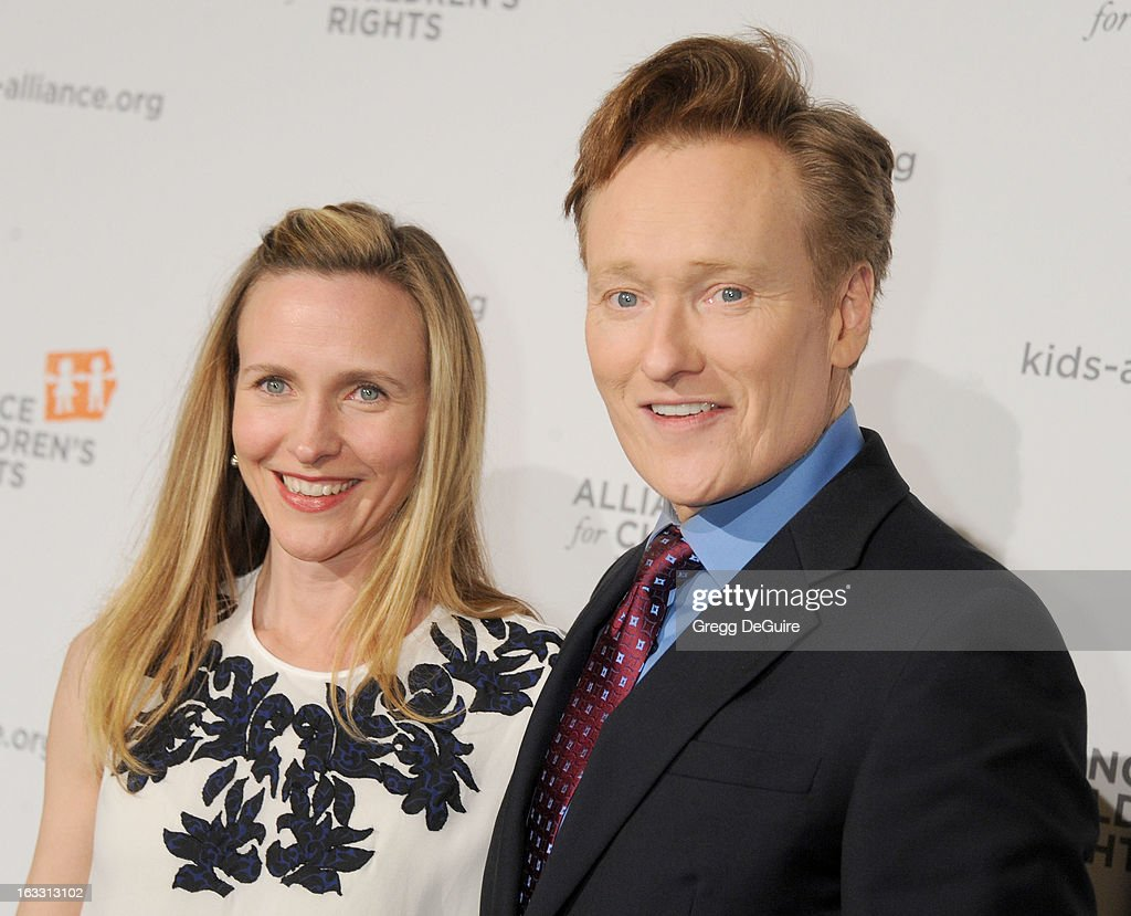 TV personality <a gi-track='captionPersonalityLinkClicked' href=/galleries/search?phrase=Conan+O%27Brien&family=editorial&specificpeople=208095 ng-click='$event.stopPropagation()'>Conan O'Brien</a> (R) and wife Liza Powel arrive at The Alliance for Children's Rights 21st Annual Dinner at The Beverly Hilton Hotel on March 7, 2013 in Beverly Hills, California.