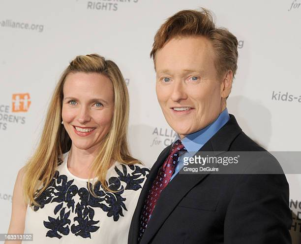 TV personality Conan O'Brien and wife Liza Powel arrive at The Alliance for Children's Rights 21st Annual Dinner at The Beverly Hilton Hotel on March...