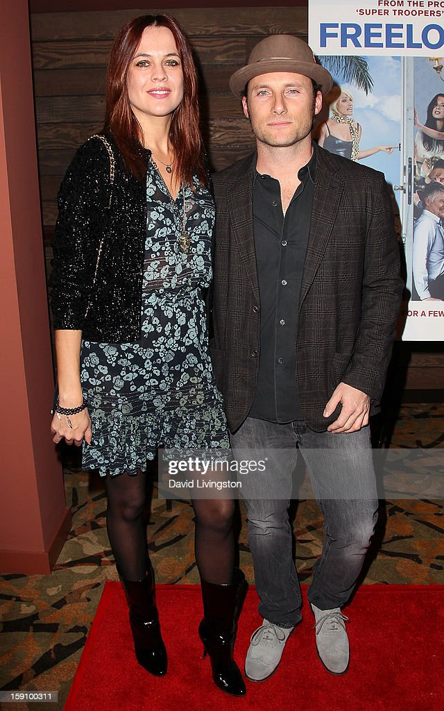 TV personality Corina Marinescu (L) and musician Christopher Stills attend the premiere of Salient Media's 'Freeloaders' at Sundance Cinema on January 7, 2013 in Los Angeles, California.