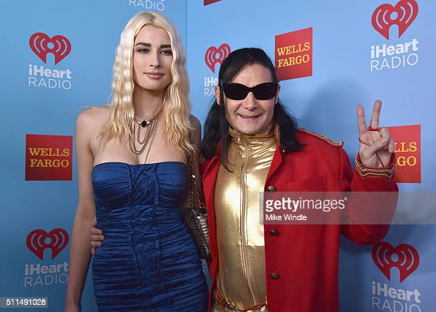TV personality Courtney Anne Mitchell and actor Corey Feldman pose backstage during the first ever iHeart80s Party at The Forum on February 20 2016...