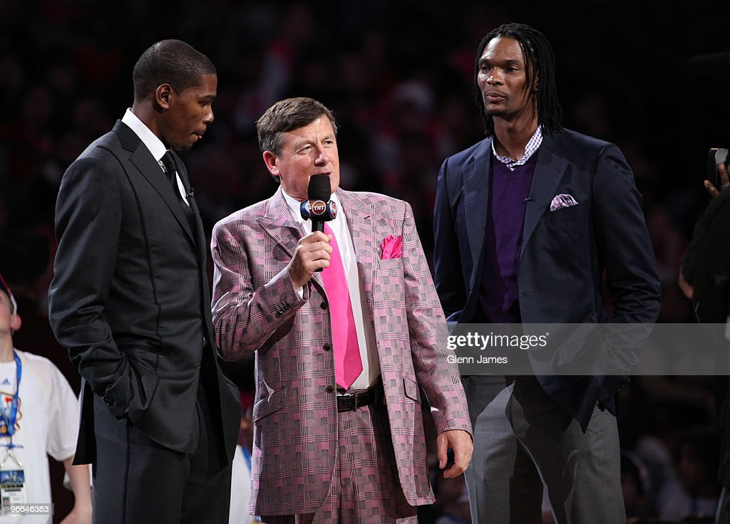 TNT personality Craig Sager talks with NBA AllStars Kevin Durant and Chris Bosh prior to tip off of the TMobile Rookie Challenge and Youth Jam as...