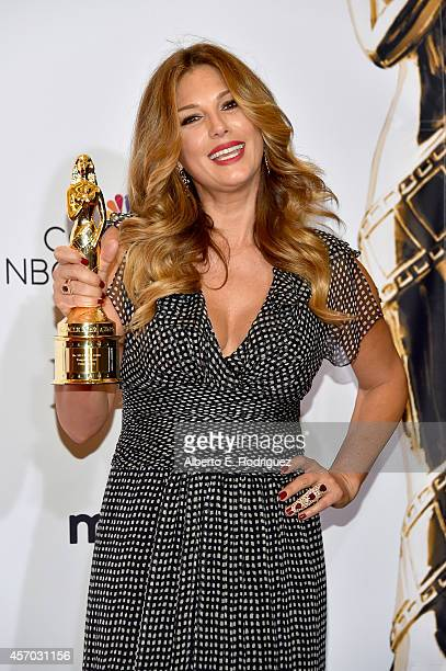 TV personality Daisy Fuentes poses with the NCLR ALMA Vanguard Award in the Winner's Walk during the 2014 NCLR ALMA Awards at the Pasadena Civic...
