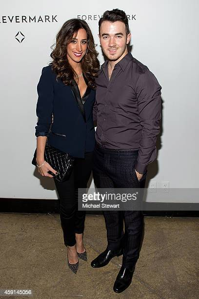 TV personality Danielle Jonas and singer Kevin Jonas attend Hold My Hand Forever Exhibition By Forevermark at Highline Studios on November 17 2014 in...
