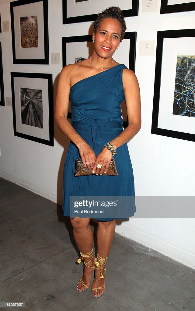TV personality <a gi-track='captionPersonalityLinkClicked' href=/galleries/search?phrase=Daphne+Wayans&family=editorial&specificpeople=4878193 ng-click='$event.stopPropagation()'>Daphne Wayans</a> attending the 'Jennie Garth: Awake' opening night artist reception at Project Gallery on April 5, 2014 in Hollywood, California.