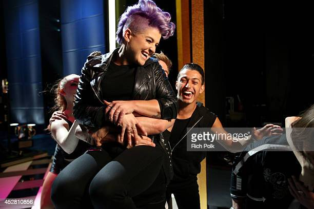 Personality Derek Hough and host Kelly Osbourne backstage at the 2014 Young Hollywood Awards brought to you by Samsung Galaxy at The Wiltern on July...