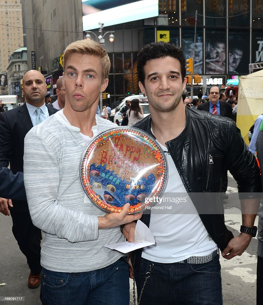 TV personality Derek Hough(L) and Mark Ballas leaves the 'Good Morning America'taping at the ABC Times Square Studios on May 22, 2013 in New York City.